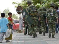 Chinese paramilitary policemen patrol a street in Kashgar city, northwest Chinas Xinjiang Uygur Autonomous Region, 23 July 2014. Chinese police shot dead dozens of knife-wielding attackers on Monday (28 July 2014) morning after they staged assaults on two towns in the western region of Xinjiang, the official Xinhua news agency …