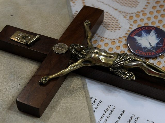 "The crucifix of Bishop Manuel Acuna on the altar during a ritual at the ""El Buen Pastor"" parish in Santos Lugares, outskirts of Buenos Aires on September 6, 2016. Acuna, 54, who defines himself as a Charismatic Lutheran Bishop and says he is member of the New York-based Association of …"