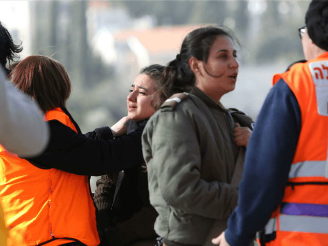 Israeli medical personnel assist an Israeli female soldier who was an eye witness to the attack where four Israeli soldiers were killed when a Palestinian truck driver ran into a group of soldiers at the Jerusalem promenade on January 8, 2017. A Palestinian rammed a truck into a group of …