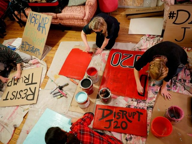 Activists gather to make signs for demonstrations against the upcoming inauguration of Donald Trump January 11, 2017 in Washington, DC. The Inauguration is expected to bring thousands of activists and supporters to Washington. (Photo by Aaron P. Bernstein/Getty Images)