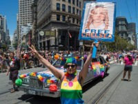 Abigail Edward holds up a sign advocating the release of WikiLeaks whistle blower Chelsea Manning along the Gay Pride parade route in San Francisco, California on Sunday, June, 26, 2016. / AFP / Josh Edelson (Photo credit should read JOSH EDELSON/AFP/Getty Images)