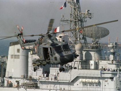 An armed French Navy helicopter aboard the French warship Dupleix takes off as the warship escorts 3 French flagged tankers out of the Gulf December 26, 1987, off the coast of Dubaï. On December 24, 1987, a U.S. Navy helicopter was shot at by Iranian speed-boats