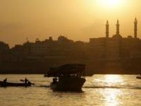 Palestinian fishermen sail their boats at Gaza's seaport in Gaza City early on August 29, 2014. Israel and Hamas accepted an Egyptian proposal for a long-term ceasefire in war-torn Gaza on August 26 in a move to end 50 days of bloodshed. Restrictions imposed on Gaza fishermen are to be …
