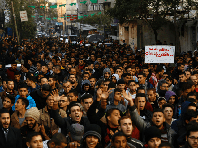 Palestinians chant slogans during a protest against the ongoing electricity crisis in Jabalia refugee camp in the northern Gaza Strip on January 12, 2017. Hamas security forces broke up a protest in the northern Gaza Strip Thursday, an AFP photographer and witnesses said, as thousands took to the streets over …