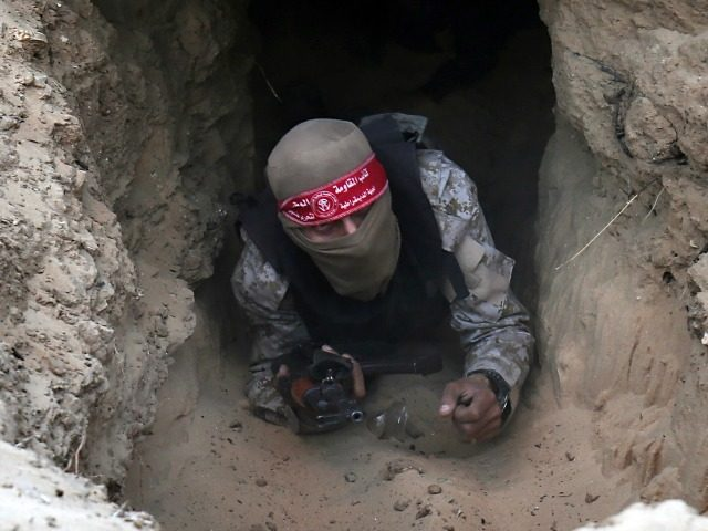 A Palestinian militant of the National Resistance brigades, the armed wing of the Democratic Front for the Liberation of Palestine (DFLP), gets out of a tunnel during a graduation ceremony in Rafah, in the southern Gaza Strip, on November 4, 2016. / AFP / SAID KHATIB (Photo credit should read SAID KHATIB/AFP/Getty Images)