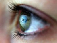 In this photo illustration the Google logo is reflected in the eye of a girl on February 3, 2008 in London, England. Financial experts continue to evaluate the recent Microsoft $44.6 billion (?22.4 billion) offer for Yahoo and the possible impact on Internet market currently dominated by Google. (Photo by …