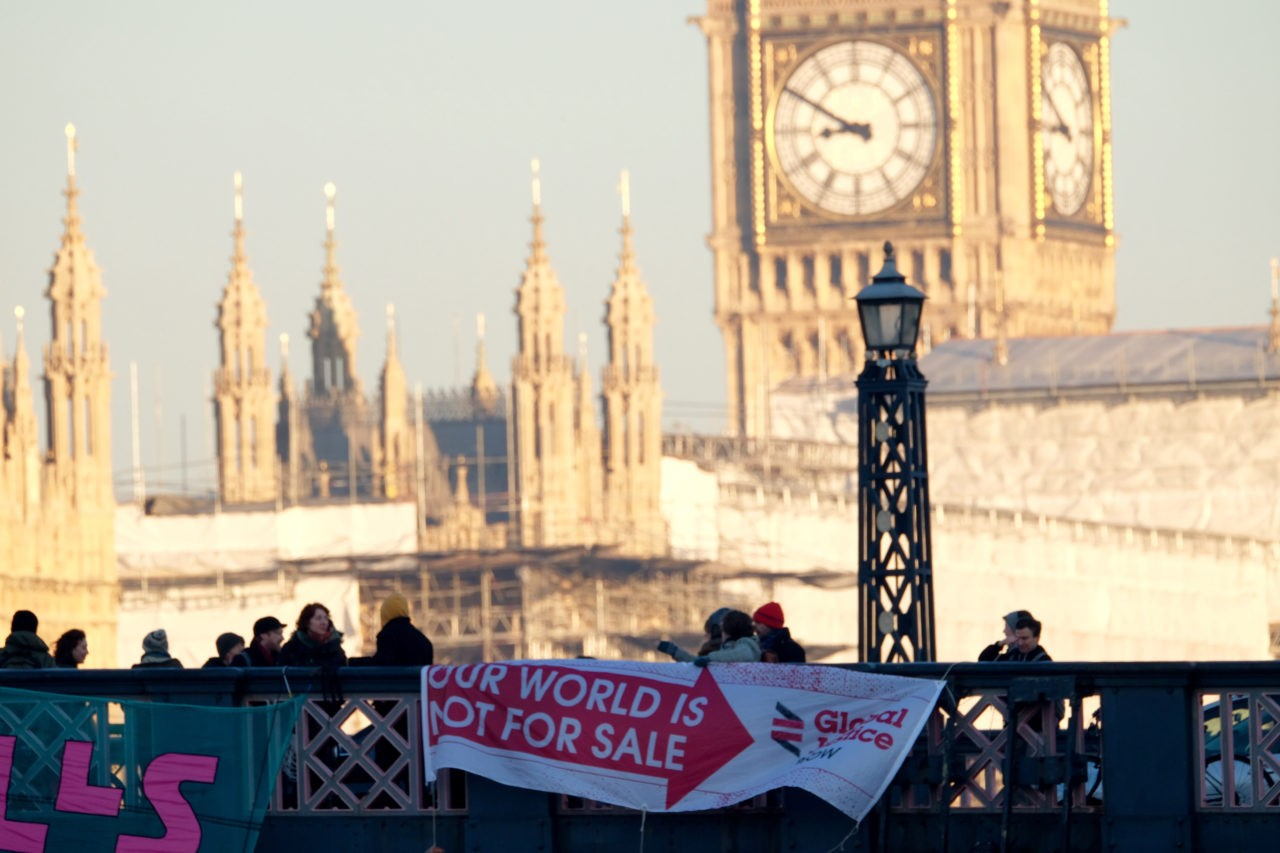 Anti-Trump protesters drop banners from London bridges