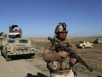 Iraqi Army soldiers deploy after defeating Islamic State militants in the eastern side of Mosul, Iraq, Tuesday, Jan. 24, 2017. The U.N. and several aid organisations say an estimated 750,000 civilians are still living under Islamic State rule in Mosul despite recent advances by Iraqi forces, and Iraq's prime minister …