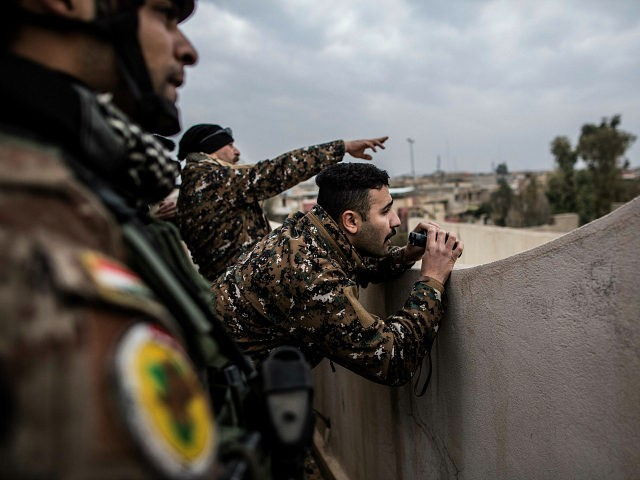Iraqi members of the Special Forces scan the area held by Islamic state militants from a roof in Mishraq district in Mosul, Iraq, Tuesday, Dec. 20, 2016. Advancing into Mosul has become a painful slog for Iraqi forces. Islamic State group militants have fortified each neighborhood, unlike past battles where …