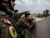 Iraqi members of the Special Forces scan the area held by Islamic state militants from a roof in Mishraq district in Mosul, Iraq, Tuesday, Dec. 20, 2016. Advancing into Mosul has become a painful slog for Iraqi forces. Islamic State group militants have fortified each neighborhood, unlike past battles where they concentrated their defenses in one part of the city. (AP Photo/Manu Brabo)