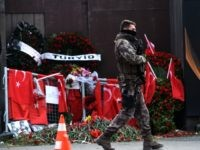 A Turkish special force police officer patrols in front of the Reina nightclub on January 4, 2017 in Istanbul, three days after a gunman killed 39 people on New Year's night. The gunman had fought in Syria for Islamic State jihadists, a report said on January 3, as Turkish authorities …
