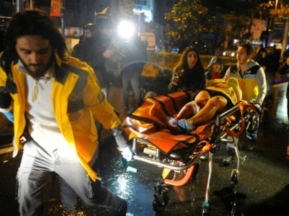 First aid officers carry an injured woman at the site of an armed attack on January 1, 2017 in Istanbul. At least two people were killed in an armed attack Saturday on an Istanbul nightclub where people were celebrating the New Year, Turkish television reports said. / AFP / IHLAS …