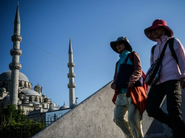 Women walk near the new mosque in Eminonu district in Istanbul, on June 9, 2016. Turkey has suffered a spate of bombings this year, including two suicide attacks in tourist areas of Istanbul and two car bombings in the capital Ankara effected tourism industry in Turkey reported by Turkish media. …