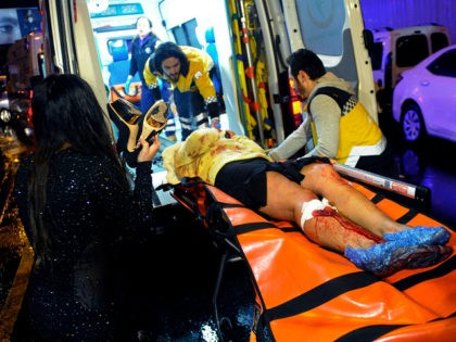 Medics carry a wounded person at the scene after an attack at a popular nightclub in Istanbul, early Sunday, Jan. 1, 2017. Istanbul Governor Vasip Sahin said that an armed assailant has opened fire at a nightclub in Istanbul during New Year's celebrations. Turkish authorities have banned distribution of images …
