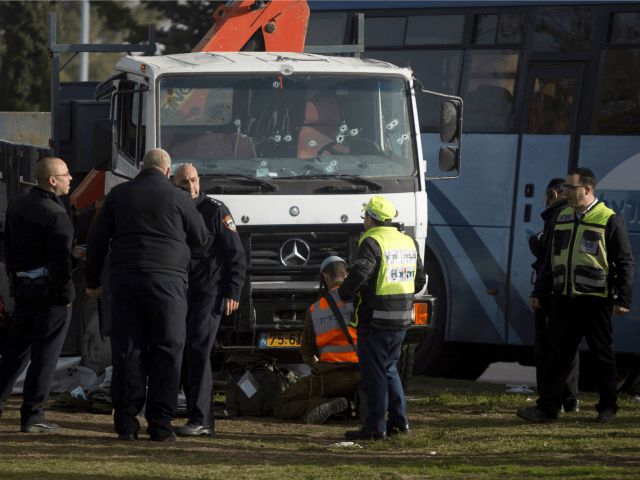 Israeli security forces and emergency personnel gather at the site of a vehicle-ramming attack on January 8, 2017 in Jerusalem, Israel. Four israeli soldiers were killed and 13 wounded after an industrial truck driven by a Palestinian man, rammed into a group of people. (Photo by Lior Mizrahi/Getty Images)