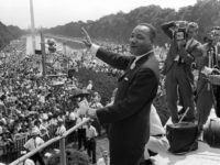 US civil rights leader Martin Luther King, Jr., waves to supporters from the steps of the Lincoln Memorial 28 August, 1963, on The Mall in Washington, DC, during the 'March on Washington' where King delivered his famous 'I Have a Dream' speech, which is credited with mobilizing supporters of desegregation …