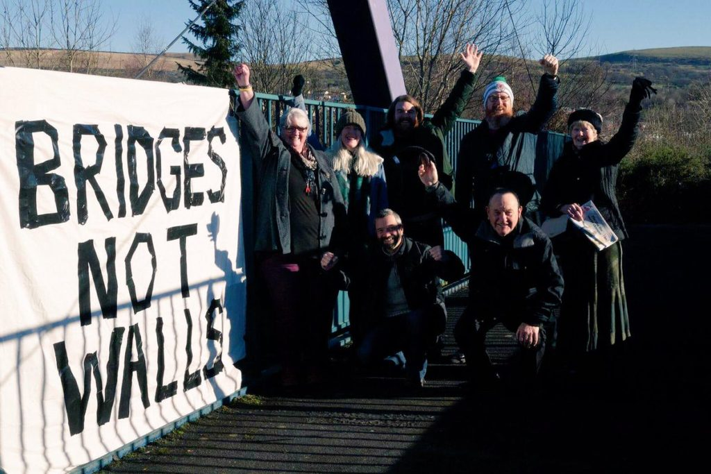 A group with their banner in Merthyr, Wales