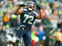 Defensive end Michael Bennett of the Seattle Seahawks celebrates on December 24, 2016 in Seattle, Washington