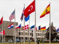 NATO country flags wave outside NATO headquarters in Brussels on Tuesday July 28, 2015. For just the fifth time in its 66-year history, NATO ambassadors met in emergency session Tuesday to gauge the threat the Islamic State extremist group poses to Turkey, and the debated actions Turkish authorities are taking …