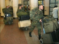 German soldiers walk after arriving at the airport Vilnius, Lithuania, on January 24, 2017. A group of German officers landed in the Baltic state's capital Vilnius to coordinate the deployment of a 1,200-strong battalion that will include forces from several NATO members. / AFP / Petras Malukas (Photo credit should …