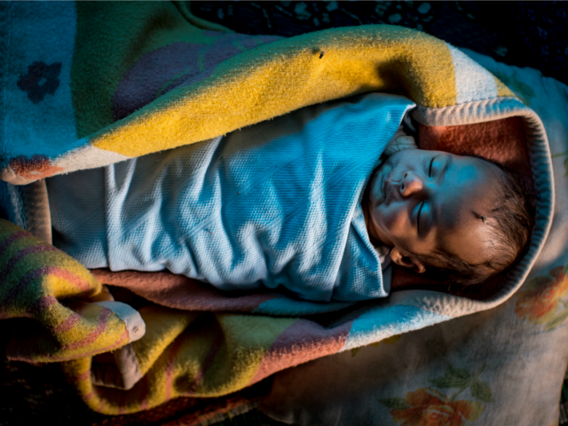 A Syrian refugee baby is seen sleeping inside amakes bread at a tent camp on the outskirts of Izmir on April 28, 2016 in Izmir, Turkey. For many Syrian refugees, living in Turkey has become their only option. With the new E.U.-Turkey deal effectively shutting down the route to Europe …