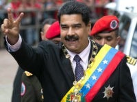 Venezuela's President Nicolas Maduro flashes a victory sign to supporters as he arrives to the Supreme Court to deliver his annual state of the nation report in Caracas, Venezuela, Sunday, Jan. 15, 2017. For more than half a century, Congress had been the body responsible for receiving the president's annual …