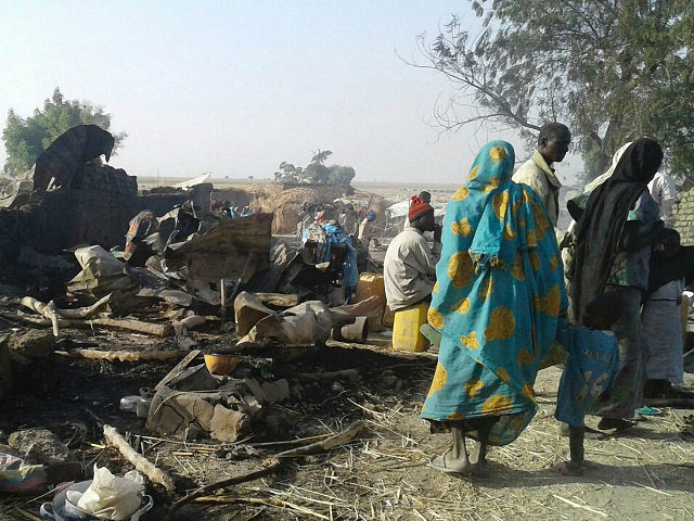 People walk at the site after a bombing attack of an internally displaced persons camp in Rann, Nigeria January 17, 2017. MSF/Handout via Reuters