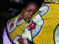 IJEBU-ODE, NIGERIA - NOVEMBER 06: 06: A Nigerian woman carries her baby in the town of Ijebu-Ode on November 6, 2009 in Ijebu-Ode, Nigeria. (Photo by Jamie McDonald - FIFA/FIFA via Getty Images)