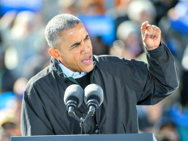 President Barack Obama delivers a speech to support  Democratic presidential candidate Hillary Clinton at Burke Lakefront Airport in Cleveland, Friday, Oct. 14, 2016. (AP Photo/Phil Long) ORG XMIT: OHPL