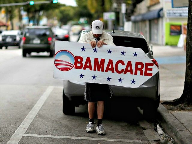 obamacare-sign-Joe Raedle Getty Images,
