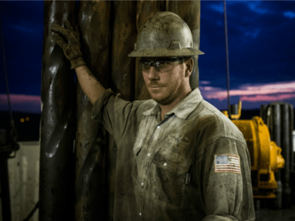 Scott Berreth, a derrick hand for Raven Drilling, works on an oil rig drilling into the Bakken shale formation on July 28, 2013 outside Watford City, North Dakota. North Dakota has been experiencing an oil boom in recent years, due in part to new drilling techniques including hydraulic fracturing and …