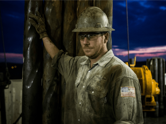 Scott Berreth, a derrick hand for Raven Drilling, works on an oil rig drilling into the Bakken shale formation on July 28, 2013 outside Watford City, North Dakota. North Dakota has been experiencing an oil boom in recent years, due in part to new drilling techniques including hydraulic fracturing and horizontal drilling. In April 2013, The United States Geological Survey released a new study estimating the Bakken formation and surrounding oil fields could yield up to 7.4 billion barrels of oil, doubling their estimate of 2008, which was stated at 3.65 billion barrels of oil. Workers for Raven Drilling work twelve hour days fourteen days straight, staying at a camp nearby, followed by fourteen days. (Photo by Andrew Burton/Getty Images)  Restrictions