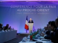 French Minister of Foreign Affairs Jean-Marc Ayrault is applauded as he addresses delegates at the opening of the Mideast peace conference in Paris on January 15, 2017. Around 70 countries and international organisations are making a new push for a two-state solution in the Middle East at the conference in …