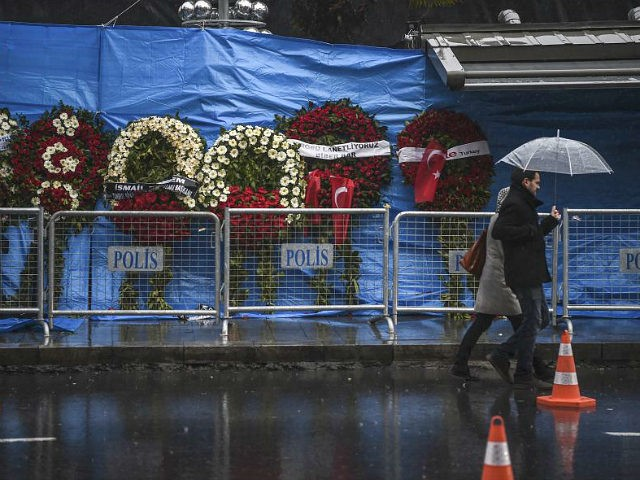 A couple walk past the Reina nightclub on January 5, 2017 in Istanbul, days after a gunman killed 39 people on New Year's night. The gunman who killed 39 people at an Istanbul nightclub had fought in Syria for Islamic State jihadists, a report said on January 3, as Turkish authorities intensified their hunt for the attacker. Of the 39 dead, 27 were foreigners, mainly from Arab countries, with coffins repatriated overnight to countries including Lebanon and Saudi Arabia. / AFP / OZAN KOSE (Photo credit should read OZAN KOSE/AFP/Getty Images)