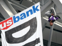 Pipeline protestors hang banner from U.S. Bank Stadium to promote cause