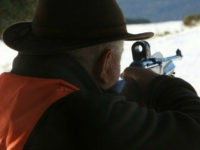 A hunter holds a rifle during a deer hunting organised by ACCA's association (Les Associations Communales de Chasse Agreees) on December 16, 2012 in Les Angles, southwestern France. AFP PHOTO / RAYMOND ROIG (Photo credit should read RAYMOND ROIG/AFP/Getty Images)
