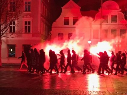 Masked far-right demonstrators hold illegal protest against north African migrants in German city of Cottbus,