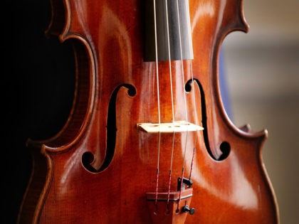 LONDON, ENGLAND - MARCH 09: Philip Dukes holds a rare 'Archinto' Stradivarius Viola at The Royal Academy of Music on March 9, 2011 in London, England. Mr Dukes will celebrate the 20th anniversary of his first recital at the Purcell Room on March 20, 2011 playing this viola dated 1696; …