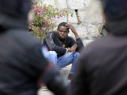 A migrant waits along the road after Italian police broke up their group at the Italy-France border, in Ventimiglia, on June, 13, 2015. The Italian police, wearing riot gear, tried to push the migrants back towards the town of Ventimiglia, five kilometres (three miles) from the border, but a group …