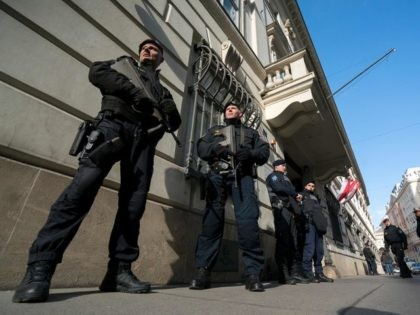 "Austrian police officers guard the entrance to the West-Balkan conference ""Managing Migration together"" at the Austrian interior ministry in Vienna, Austria on February 24, 2016. Austria hosts talks with countries along the well-trodden migrant path through the western Balkans to northern Europe, as tighter border controls raise fears of a …"