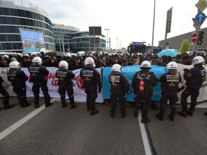 STUTTGART, GERMANY - APRIL 30: Anti-AFD demonstrators and police forces face near the AfD (Alternative fuer Deutschland) party's federal congress at the Stuttgart Congress Centre ICS on April 30, 2016 in Stuttgart, Germany. The AfD, a relative newcomer to the German political landscape, has emerged from Euro-sceptic conservatism towards a …