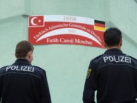 Two policemen stand in front of the Fatih Camii Mosque in Dresden, eastern Germany, on September 27, 2016, after a bomb attack. Bomb attacks hit a mosque and a congress centre in the eastern German city of Dresden, police said, addding that they suspected a xenophobic and nationalist motive. No-one …