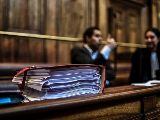 Documents are pictured while lawyers prepare for the opening day at the Lyon courthouse on November 3, 2016 of the trial of 5 men suspected of Change Migros Thonex's robbery in November 2010 in Geneva. The attack of the Change Migros Thonex's on November 26, 2010, by a dozen of …