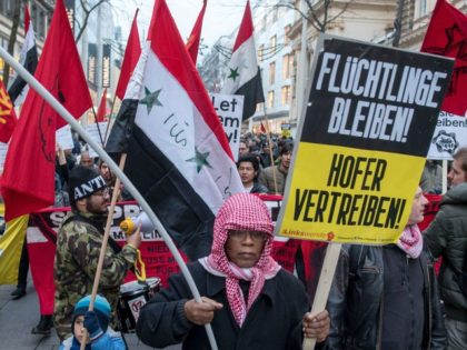 "Austrian citizens and asylum seekers march during a pro-refugee protest called ""Let them stay"" in Vienna, Austria on November 26, 2016. Austria will hold the postponed second round of the presidential elections on December 4, 2016. / AFP / JOE KLAMAR (Photo credit should read JOE KLAMAR/AFP/Getty Images)"