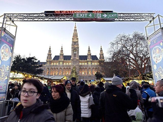 Tourists and citizens take part in the New Year eve celebrations in Vienna, on December 31, 2016. / AFP / APA / HANS PUNZ / Austria OUT (Photo credit should read HANS PUNZ/AFP/Getty Images)