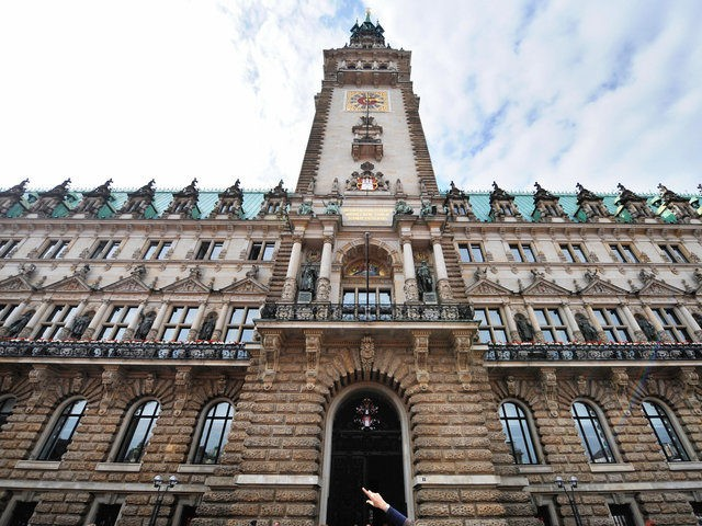 A woman points at Hamburg's town hall (Rathaus), the seat of the city state's local government and of the Mayor of Hamburg taken on September 10, 2008. AFP PHOTO / JOHN MACDOUGALL (Photo credit should read JOHN MACDOUGALL/AFP/Getty Images)
