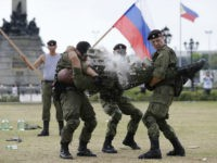 A Russian Marine uses a hammer to break a brick on top of his comrade's stomach during a Capability Demonstration at Manila's Rizal Park, Philippines on Thursday, Jan. 5, 2017. Russia is eyeing naval exercises with the Philippines and deployed two navy ships for a goodwill visit to Manila as …