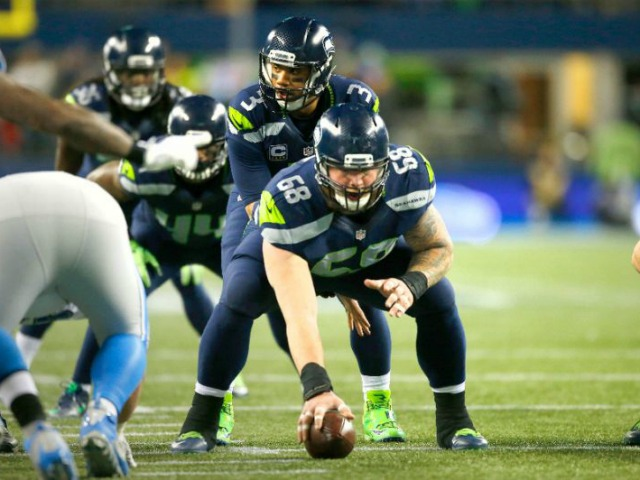 Quarterback Russell Wilson of the Seattle Seahawks gets ready to run a play against the Detroit Lions in the NFC Wild Card game