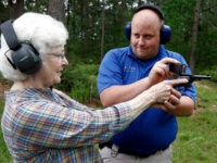 In this April 30, 2016 photograph, Jake Driskell, a Laurel police officer and owner of Gun Guy Tactical, helps Crestview Baptist Church member and first time shooter Katherine Huffman, line up her sights with her husband's revolver during the live fire portion of a enhanced concealed carry class sponsored by …