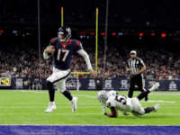 Brock Osweiler #17 of the Houston Texans rushes for a touchdown during the fourth quarter of the AFC Wild Card game against the Oakland Raiders at NRG Stadium